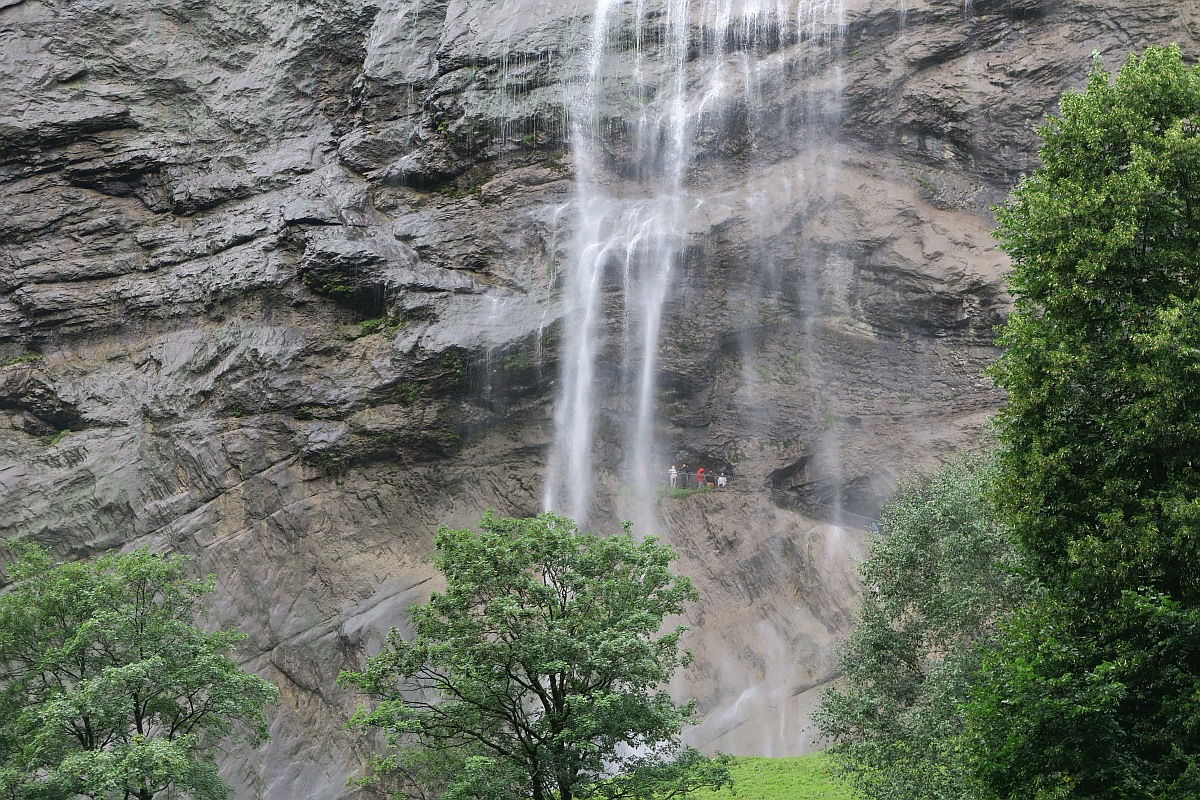 Can you spot the people behind Staubbach falls